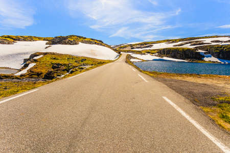 Road running through summer norwegian hills mountains. Beautiful landscape. Norway.
