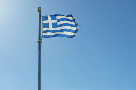 Close up of blue nad white Greek flag waving on wind. National landmark concept.