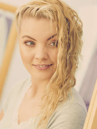 Happy woman having wet blonde hair. Positive clean female after taking a shower feeling clean and relaxed.