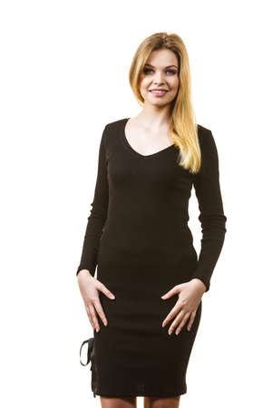 Pretty beautiful woman wearing stylish short black dress. Teenage presenting elegant outfit.