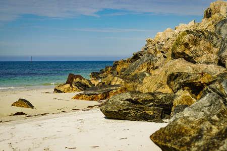Seascape with stone breakwater, Bleik village, Andoya island, Vesteralen archipelago. Stock Photo