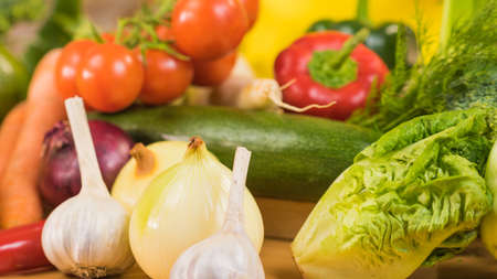 Many healthy colorful vegetables on kitchen table. Dieting, vegetarian local fresh food, natural source of vitamins. 스톡 콘텐츠