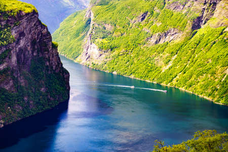Tourism vacation and travel. Beautiful view over magical Geirangerfjorden from Ornesvingen viewpoint, Norway Scandinavia.