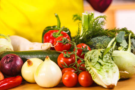 Close up of many healthy vegetables on kitchen table. Various colorful veggies, vegetarian meal ingredients.