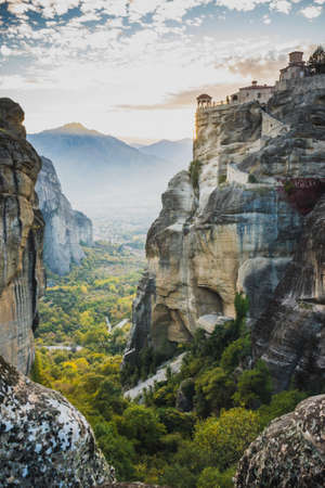 Scenic sunset evening sky over holy Varlaam monastery on cliff in Meteora, Thessaly Greece. Greek destinations Standard-Bild - 119489617