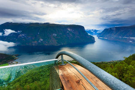 Aurlandsfjord landscape from Stegastein viewing point, clouds over sea water surface. Norway Scandinavia. National tourist route Aurlandsfjellet. Stock Photo