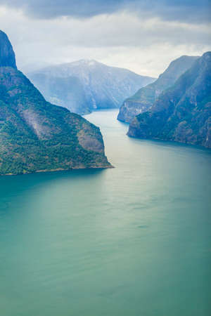 Tourism and travel. Scenic nature landscape. View to picturesque Aurlandfjord and Sognefjord from Stegastein viewpoint, Norway Scandinavia. Stock Photo