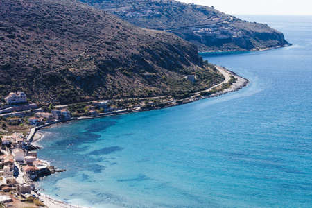 Sea landscape rocky coastline with resorts village, Peloponnese Greece, mediterranean Europe Banco de Imagens