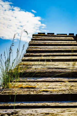 Old wooden stairway to blue sky heaven