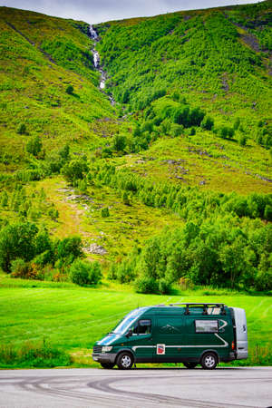 Camper car in mountains on roadside. Camping on trip. Norway Scandinavia Europe.