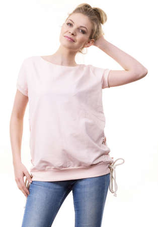 Adult woman presenting her casual beautiful outfit, short sleeved pink top and jeans.