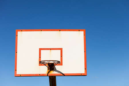 basketball board with basket hoop against blue sky. Sport, recreation. 스톡 콘텐츠