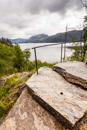 Norwegian landscape. Green mountains hills and fjord Saudafjord on overcast weather, view from Svandalsfossen waterfall area. National tourist Ryfylke route. Stock fotó
