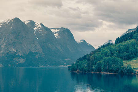Tourism vacation and travel. Mountains landscape dark stormy clouds and fjord in Norway Scandinavia Europe. Beautiful nature Stock fotó