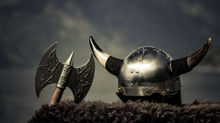 Viking helmet with axe on fjord shore in Norway. Tourism and traveling concept Banco de Imagens