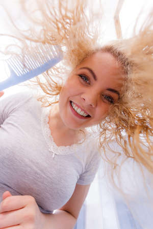 Happy woman having wet blonde hair. Positive clean female after taking a shower feeling clean and relaxed. Unusual crazy bottom angle.