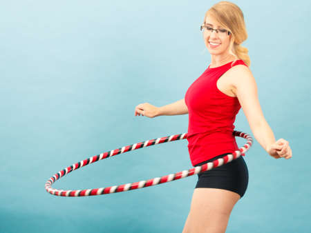 Fitness, activity, healthy lifestyle. Young blond woman doing exercise 免版税图像