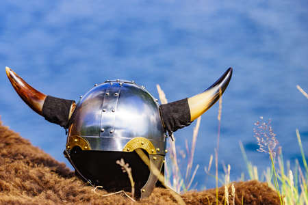 Viking helmet on fjord shore in Norway. Tourism and traveling concept