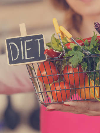 Shopping basket with diet sign and many colorful vegetables. Healthy eating lifestyle, vegetarian food.