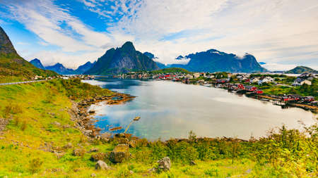 Beautiful scenery fjord landscape with Reine village, coast nature with sharp high mountain peaks, Lofoten islands North Norway. Travel destination.