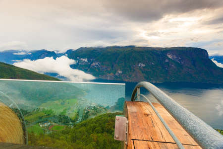 Aurlandsfjord landscape from Stegastein viewing point, clouds over sea water surface. Norway Scandinavia. National tourist route Aurlandsfjellet.