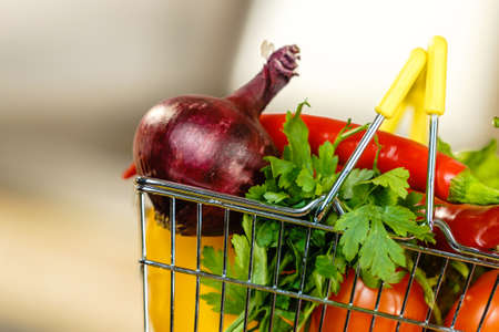 Shopping basket with many colorful vegetables. Healthy eating lifestyle, nutrients vegetarian food. Stock Photo