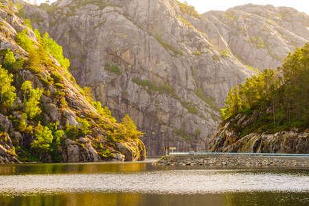 Norwegian mountains landscape. Empty road along fjord.