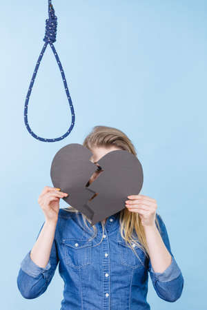 Sad depressed woman thinking about suicide after having broken heart. Relationship breakup problem, depression concept. 写真素材 - 129683120