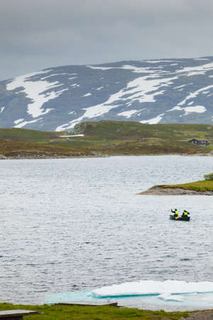 Tourism vacation and travel. People kayaking in lake, Haukeli in summer, Norway.
