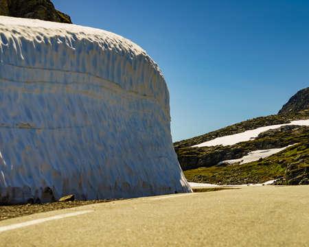High snow wall and mountain road Aurlandsvegen between Aurland and Laerdal in Norway, summer time Reklamní fotografie