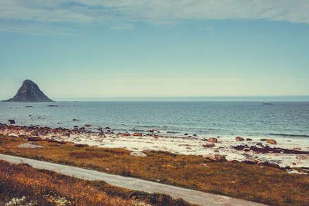 Seascape, sea coast with sandy beach and island Bleiksoya in the distance, resort Bleik Andoya Norway. Vesteralen archipelago. Reklamní fotografie