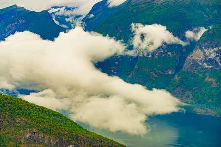 Aurlandsfjord fjord landscape with clouds over sea surface. Norway Scandinavia. National tourist route Aurlandsfjellet.