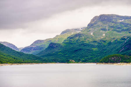 Lake in mountains, foggy day. Norway summer landscape. Norwegian national tourist scenic route Ryfylke.