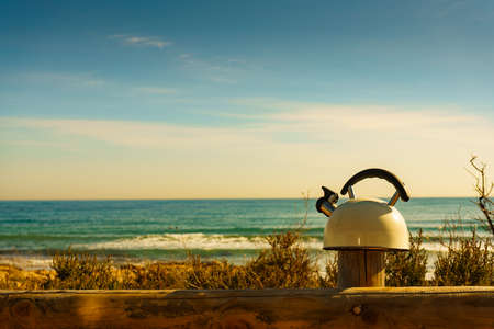 Kettle outdoor on sea shore. Travel, camping on nature 写真素材