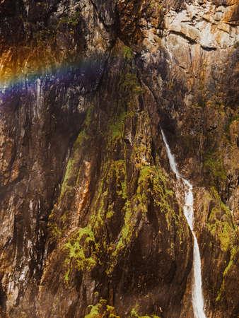 Voringsfossen waterfall with rainbow in summer, Mabodalen valley Norway. National tourist Hardangervidda route, touristroad 7, Eidfjord sightseeing tour. Reklamní fotografie