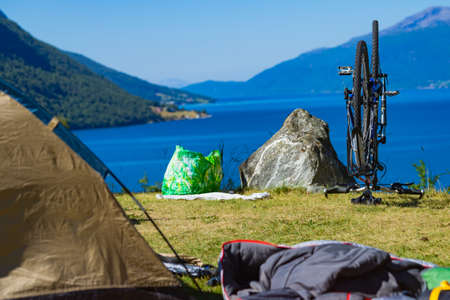 Bike repair. Mountain bicycle against nature, mountains fjord landscape in Norway Reklamní fotografie