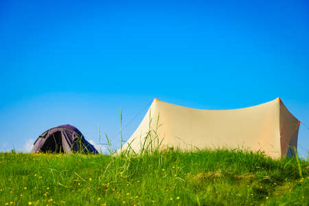 Camping. Tent on nature against blue sky. Holidays and travel.