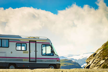 Camper car on roadside in norwegian mountains. Traveling, holidays and adventure concept. Norway Scandinavia Europe. Stock fotó