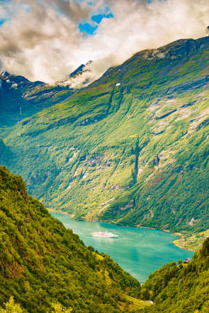 Fjord Geirangerfjord with big cruise ship, view from Ornesvingen viewing point, Norway. Travel destination