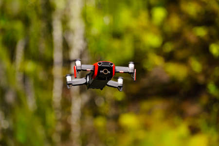Drone flying against norwegian nature, mountain waterfall, take photo and video