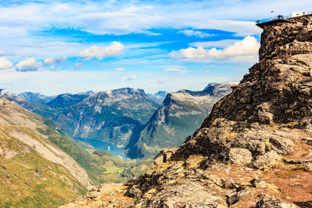 Panoramic mountains landscape with Geirangerfjord from Dalsnibba area. Geiranger Skywalk viewing platform on mountain in distance. Norway.