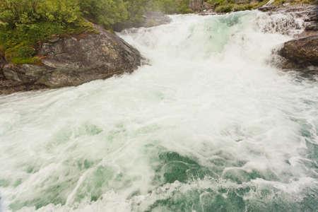 Travel, beautiful nature. Videfossen called Buldrefossen waterfall in Norway Sogn og Fjordane