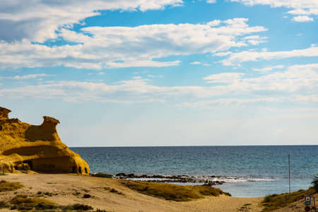 Cocedores Beach with yellow sand formations at Mediterranean sea, Murcia region Spain. Stock Photo