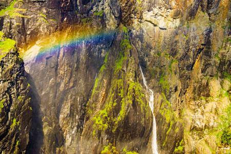 Voringsfossen waterfall with rainbow in summer, Mabodalen valley Norway. National tourist Hardangervidda route, touristroad 7, Eidfjord sightseeing tour. Zdjęcie Seryjne