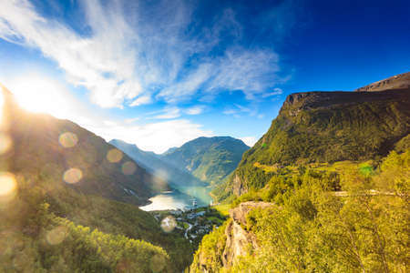 Fjord Geirangerfjord with cruise ship at sunset, view from Flydalsjuvet viewing point, Norway. Travel destination