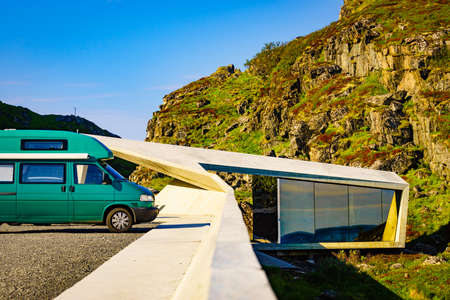 Camper van on rest stop location Bukkekjerka viewing point. Andoya island rocky coastline, Vesteralen archipelago, Norway.