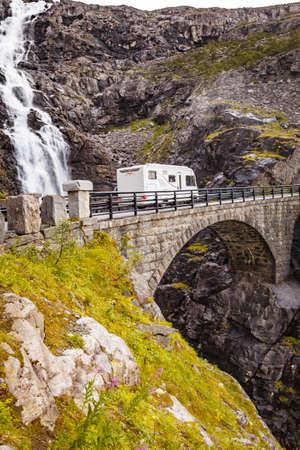 Tourism vacation and travel. Camper van in summer mountains landscape. National tourist route Trollstigen Trolls Path.