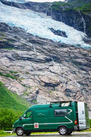 Camper van motor home in mountains and Boyabreen Glacier in Fjaerland area in Sogndal Municipality, Norway. Zdjęcie Seryjne