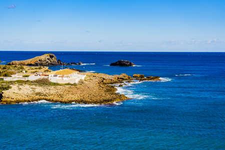 Mediterranean Sea coast landscape, spanish coastline in Murcia region. Tourist site. Cala Reona in Cabo de Palos.