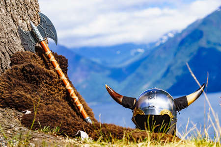 Viking helmet with sword on fjord shore in Norway. Tourism and traveling concept 版權商用圖片
